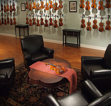 Violin on display in Menchey Music stringed instrument showroom