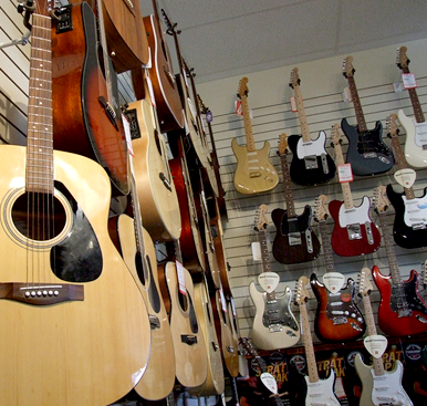Acoustic and electric guitars on display in the store
