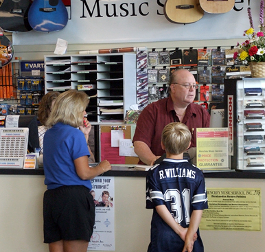 Parent and student at Menchey Music store